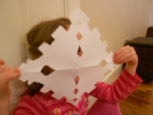 cutting paper snowflakes