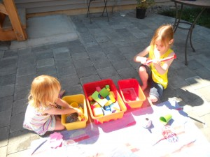 kids washing toys outside
