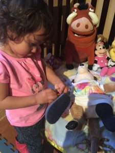 playing with stuffies and dolls