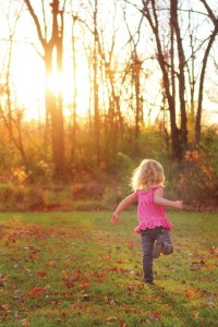 dancing outside in fall leaves