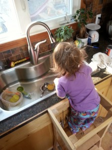child playing at kitchen sink