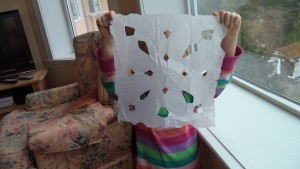 play with paper snowflake